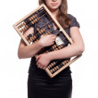 Girl with big wooden accounts and money — Stock Photo