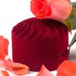 Closed box and lying next to rose petals — Stock Photo