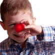 A little boy with a clown nose — Stock Photo