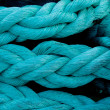 Marine rope knotted blue pigtail - Stock Photo