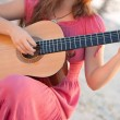 Stock Photo: Girl in dress playing guitar