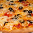 Stock Photo: Pizzwith black olives and melted cheese, close-up