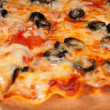 Stock Photo: Pizza with black olives and melted cheese, close-up shooting