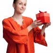 Girl in orange smock with gift — Stockfoto #6460143
