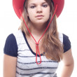 Portrait of a girl in a red hat — Stock Photo