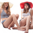 Stock Photo: Two girls in summer hats