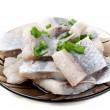 Pieces of herring on a plate — Foto Stock
