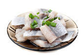 Pieces of herring on a plate — Stock Photo