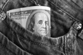 American dollar bills in jeans — Photo