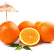 Fresh orange and umbrella — Stock Photo