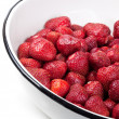 Clean strawberries in white bowl - Stock Photo