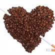 Coffee beans in the shape of the heart with cigarettes — Stock Photo #5995442