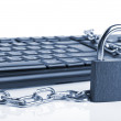 Computer keyboard and lock - Stock Photo