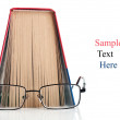 Open book and glasses — Stock Photo