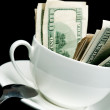 Stock Photo: White cup full of dollars