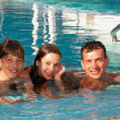 Happy family in the swimming pool — Stock Photo #5949557