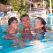 Happy family in swimming pool — Stock Photo #5949571