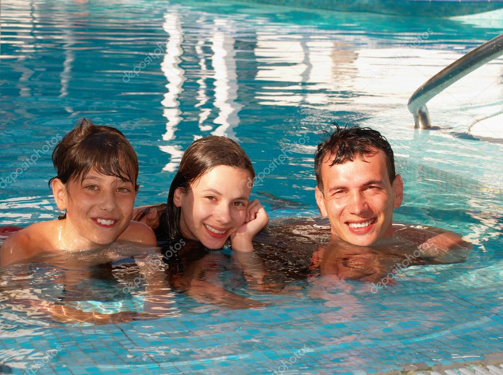 Happy family in the swimming pool stock photo boudikka for Family swimming pool