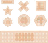 Set of plasters isolated on white — Stock Vector