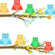 Family owls sitting in tree branches with flower — Stock Vector
