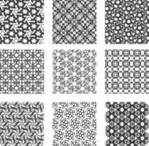 Set of black and white geometric patterns — Stock Vector