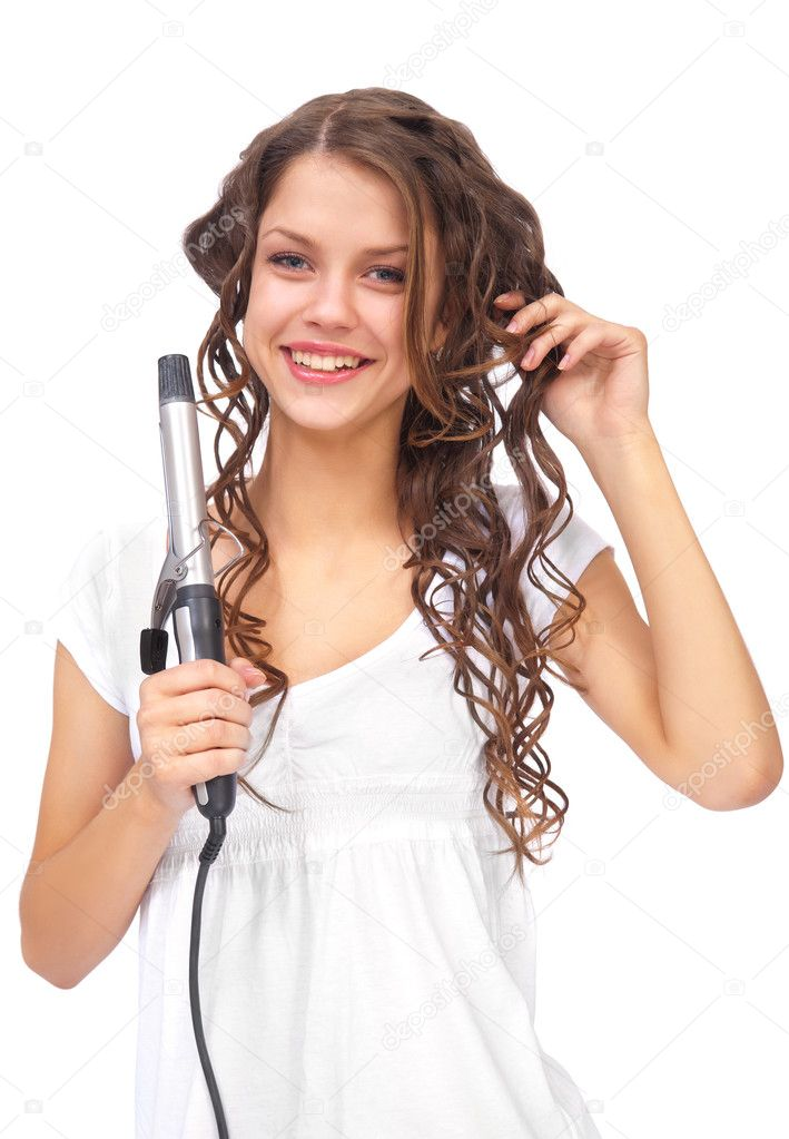 Girl with curly hair biting hair dryer  Stock Photo #5439177