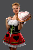Pretty housewife with a big cake — Stock Photo