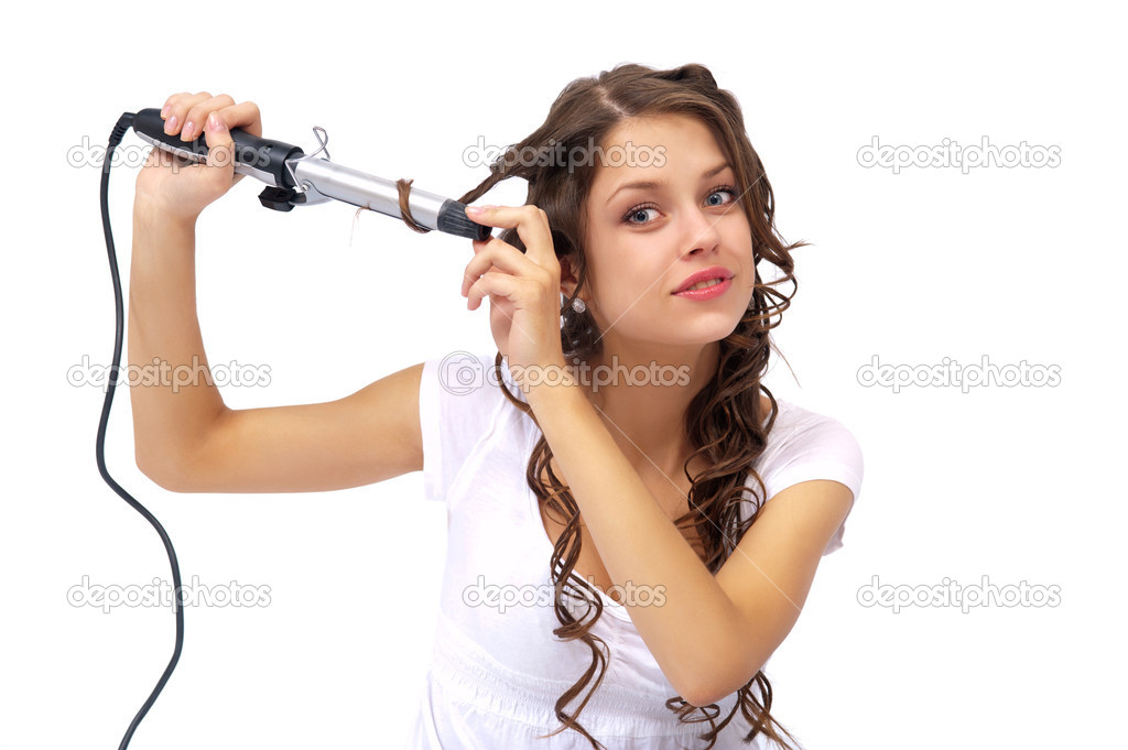 Girl with curly hair biting hair dryer. Isolated background — Stock Photo #5661826