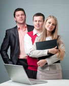 Two men and woman working with a computer — Stock Photo