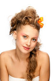 Beautiful girl with an elegant hairstyle — Stock Photo