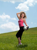 Woman in sportswear with a soccer ball — Stock Photo
