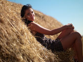 Woman on a haystack — Stock Photo