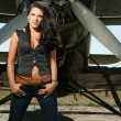 Woman in jeans and aircraft — ストック写真