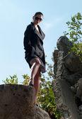 Meisje in een regenjas — Stockfoto