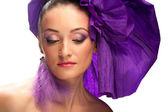 Portrait of a woman in a purple hat — Stock Photo