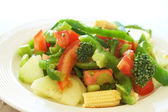 Fresh salad with cucumber, tomato and peppers — Stock Photo