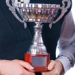 Stock Photo: Prize-winning cup in hands