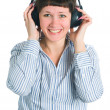 The girl listens to music — Stock Photo #5445534