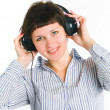 The girl listens to music — Stock Photo #5445549