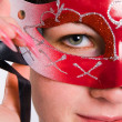 The girl in carnival to a mask — Stock Photo