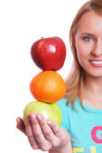 The girl holds on a palm a green and red apple — Stock Photo