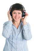 The girl listens to music — Stock Photo