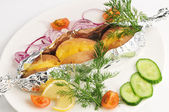 The baked potato in a foil with a garnish — Stock Photo