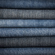 A pile of different types of blue denim jeans closeup — Stock Photo #5931640