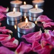 Candles and petals — Stock Photo