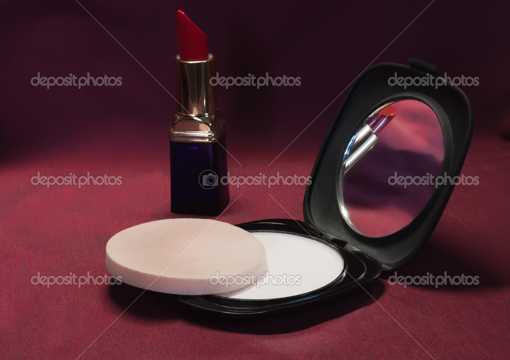 Red lipstick and powder on a fabric — Stock Photo #5772220
