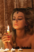 Woman with a candle — Stock Photo