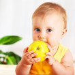 Little baby eating apple — Stock Photo