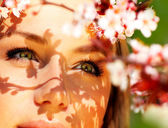 Young female face with flowers — Stock Photo
