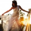 Happy bride over sunset — Stock Photo #5520767